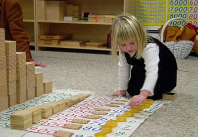 Child learning fractions at Montessori School of Syracuse