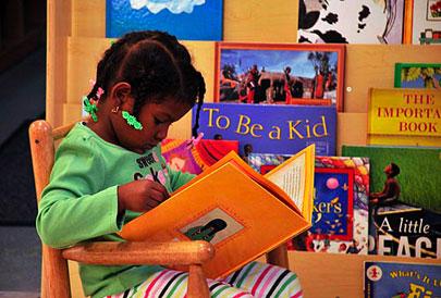Child reads in Montessori School library