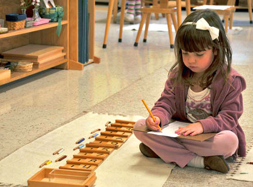 Montessori student using seguin board for math