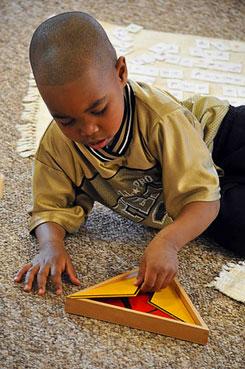 Child learning math at Montessori School